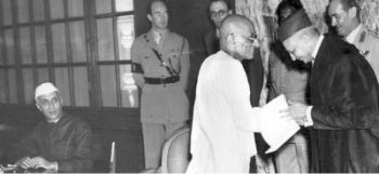 JUSTICE HARILAL KANIA, the first Chief Justice of India, felicitating Governor-General C. Rajagopalachari in November 1947 as Prime Minister Jawaharlal Nehru watches.